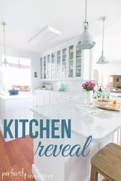 love this white kitchen and the bar with an island... oh and the pantry hutch!!