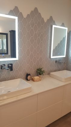 Oversized hexagon tile with an unfinished edge adds an unexpected dimension to a bathroom