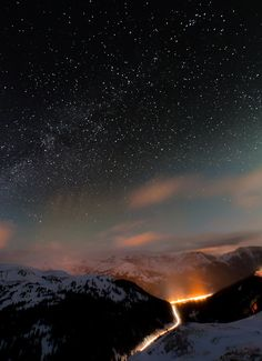 Starry night over snowy mountains