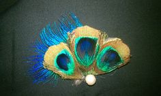 Peacock feathers. Must acquire. One day. #etsyfollows