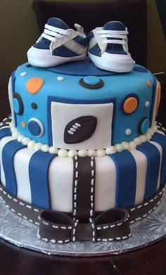Two Tier Blue And White Baby Shower Cake For Boy With Little Sneakers On Top...Click On Picture To See This & Pictures Of Many More Baby Shower Cake Ideas...