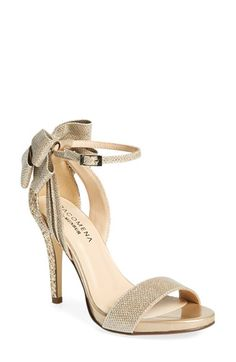 Free shipping and returns on Menbur 'Celosia' Bow Ankle Strap Glitter Sandal (Women) at Nordstrom.com. Dazzling glitter and a layered bow in back dial up the event-ready drama of a lithe ankle-strap sandal.
