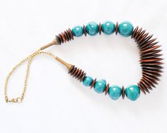 Kazuri Bead Teal Necklace  Fair Trade African by TheCoastalDesert The Coastal Desert Kenyan hemp ceramic blue bronze wood upcycled recycled repurposed handmade jewelry jewellery color colour statement chunky
