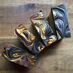 sandalwood soap. It is as decadent as it looks. Your skin will thank you. Featuring Rhassoul clay and swirled with Australian red clay, activated charcoal and gold mineral mica. Enriched with fresh goat milk and organic shea butter. #claysoap  #sandalwood  #handmade