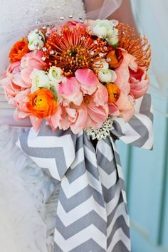 This is an example of using a different coordinating fabric with bouquet like I was talking about. Pink peonies and orange spider lilies tied with a grey and white chevron bow. #bouquet