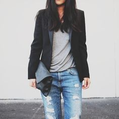 Great basic style. Boyfriend jeans, black leather detailed blazer and leather clutch.