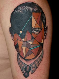 Geometric tattoo of a man's face. I love these. they look like stained glass.