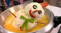Frosty the Cheeseball Man - made of three Velveeta balls stacked and frosted with cream cheese and decorated with veggies. Proudly present him in an electric skillet to party guests then plug it in. In 30 minutes, he melts into cheesy fondue dip! charles_phoenix_frosty_cheeseball_man_melted.jpg