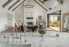 White interior with pitched ceiling, exposed beams, and pocket doors. Home dreams! Modern Farmhouse Interiors, Modern Farmhouse Style, White Farmhouse, Classic Interior, Modern Interior, Interior Design Inspiration, Decor Interior Design, White Marble Bathrooms, Indoor Outdoor Living