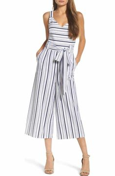 5e699876bcde Layer this strapless wide-legged jumpsuit with a blazer in the boardroom  and take it off for a great look after hours.