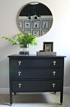 Vintage dresser painted with Sherwin-Williams Tricorn Black and round brass Threshold mirror.