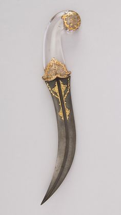 Jambiya Dagger • Dated: 18th–19th century • Culture: Persian • Medium: steel, crystal, gold • Measurements: H. 13 3/16 in. (33.5 cm); H. of blade 8 3/4 in. (22.2 cm); W. 2 1/2 in. (6.4 cm); Wt. 11.6...