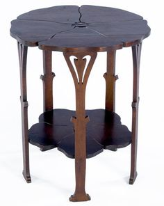 """GUSTAV STICKLEY: Early maple Poppy table (no. 26), with carved floriform top, lower shelf, and legs, ca. 1900. Fine original finish, professional restoration to chip on one foot. Unsigned. 23 1/2"""" x 20"""""""