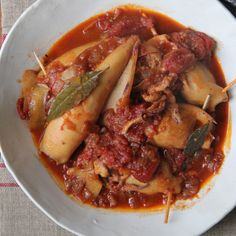 The chorizo and bread stuffing in this Portuguese seafood classic soaks up the juices of the squid as they braise in a complex sauce of wine, stock and tomatoes. Fish Dishes, Seafood Dishes, Seafood Recipes, Cooking Recipes, Squid Dishes, Shellfish Recipes, Chorizo, Calamari Recipes, Squid Recipes