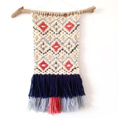 Woven wall hanging in Indigo =m badge, and clay. This weaving is made out of roving, wool, cotton. 12x16 The length of fringe at the bottom may be