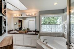 Traditional Master Bathroom with High ceiling, Complex Granite Tile, complex granite tile counters, European Cabinets