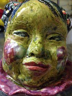 Ceramic Child with down syndrome, werk van Marjon.