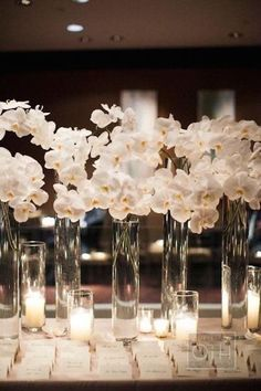 white wedding centerpiece idea for place card table; photo: Christian Oth Studio;
