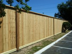8 ft Cedar cap top fence with 2x6 rot board. 2x6 Cedar trim facia every 21 ft.