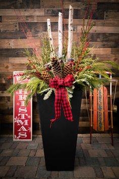 """Our Sonata planter is bursting with holiday nostalgia, in traditional green pine and red winter berry! We love the textured layers of pine, cedar and birch logs, tucked with curly willow, berries & pine cones from container design expert June Spanier! Photo credit: Dane Nelsen Featured: 36"""" Sonata planter made from recycled rubber from used car tires diverted from landfill. The rubber makes the planter durable, able to withstand temperatures to -40 degrees without cracking! Outdoor Christmas Planters, Outdoor Pots, Christmas Ideas, Christmas Crafts, Christmas Decorations, Xmas, Container Design, Container Plants, Birch Logs"""