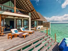 These resorts underscore the world's most wonderful accommodation—the overwater bungalow. Warning: Pangs of extreme wanderlust may follow.