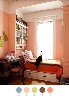 Peachy pink walls, which look fantastic with lime green and orange accents. Doesn't that sunny window seat look like a comfortable spot to work from?