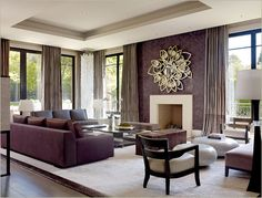 Spare, yet luxurious living room. Love the tray ceiling and the way the window treatment headers are hidden. Sculpture/light fixture in the corner adds drama and interest. Rachel Laxer Interiors