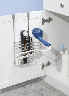 Organize under your sink with a basket that fits all your hair tools. | 47 Storage Ideas That Will Organize Your Entire House