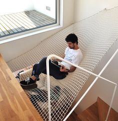 Fancy - Indoor Hammock Bed--yeah, you sit there suspended over the stairwell. I will be just fine and dandy in this chair over here on the FLOOR!
