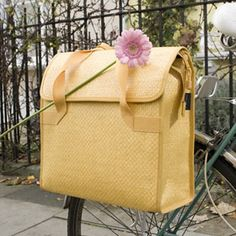 sold out everywhere i look...Deluxe Shopper Pannier in Lemon $80 from the Bicycle Muse. I wonder who got their lucky paws on this one