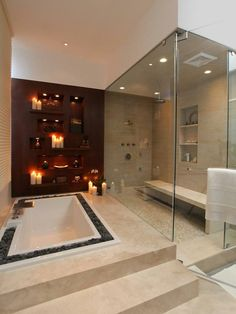 Love the rocks surrounding the tub and the large steam room / shower with the bench.