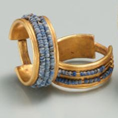 Beaded Penannular Earring Period: New Kingdom Dynasty: Dynasty 18 Reign: reign of Ahmose–Thutmose III Date: ca. 1550–1425 B.C.