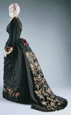 A sublimely pretty black and gold Worth day dress (ca. 1878-80) that comes by way of the Philadelphia Museum of Art. #dress #costume #clothing #Victorian #vintage #antique #historical #black #gold #beautiful #fashion #1800s #19th_century