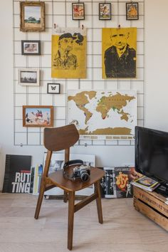 Jolien's retro Jacob chair in Natural Walnut and picture wall hung on wire. | MADE.COM/Unboxed