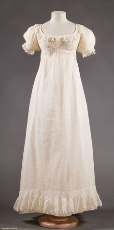 Sprigged white mull dress, covered in small tambor stitched circles, with embroidered ruffled flounce. c1820. American? Augusta Auctions.