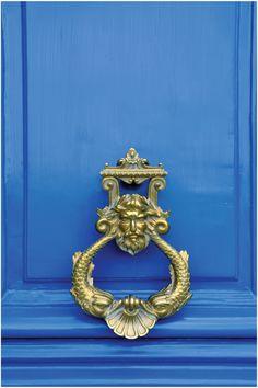beautiful brass door knocker - love that shade of blue