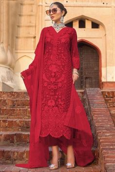Elegance and charm is what you will exude once you get this Red Net Trouser Suit which will make all the goddesses of love and beauty to write you for your advice. This V neck and Quarter Sleeves dress embroidered with stone, sequins and dori work.  Accompanied by a matching Santoon Trouser in Red Color with Red Net Dupatta. Dupatta embroidered with Stone, Sequins and Dori Work.  This Trouser Suit can be customised up to 44 Inches around the Bust.