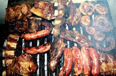 Asado - we do this every summer several times, using my MIL's old Uruguayan wooden plates.  So meat-centric!