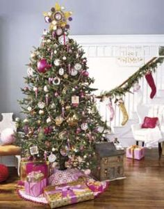 A pink and gold color scheme fills the room, from coordinating ornaments, presents, and stockings st... - Keith Scott Morton