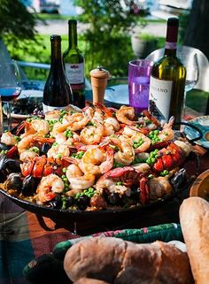 A spectacular medley of colors and tastes — Spain's world famous rice dish.  Vary this recipe as you wish. Different types of shellfish, pork and poultry can be added ... just be sure to keep the basic proportions the