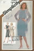 An unused original ca. 1981 Simplicity Pattern 9910.  Misses' Dress with Extended Shoulders and Unlined Coat ... Adjustable for Miss Petite:  Slim-fitting, sleeveless dress V. 1 and 2 has bust darts, elastic waistline casing, back zipper and optional tie belt. Three-quarter length coat has bust darts and extended shoulders. V. 1 has long sleeves. V. 2 has short kimono sleeves and purchased crocheted lace trim.