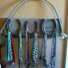 Cowgirl jewelry hanger - great way to use horseshoes from special horses......