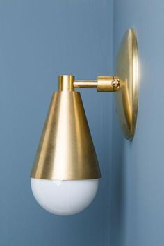 Solid brass wall sconce. The sconce looks great in any direction. Dimensions: Cone: 4H X 3-3/8W Wall Mount: 5W X 15/16H The Sconce extends 4 inches from wall. All lamps are made with new UL approved c