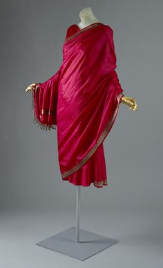 Magenta silk cocktail dress by Madame Grès (Alix Barton), French, ca. 1960. Always sympathetic to the sari—its function to wrap and its propagation of bias as a consequence of spiraling drapery—Madame Grès was particularly influenced by her research sojourn in India in the 1950s.