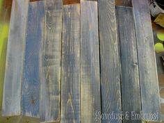 "^How to make new boards look like old barn wood-have done this. [Using tea stain will brown, vinegar/steel wool will age. Whitewash with very diluted white paint to let ""age"" show through.]"
