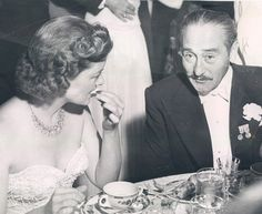 Myrna Loy and Adolphe Menjou at the French-British War Relief ball at the Coconut Grove, 1940