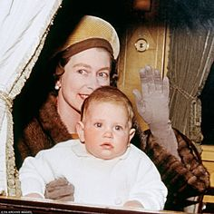 Hold tight, Mum: Prince Edward looks a little overawed about a journey to Sandringham by royal train in 1964.