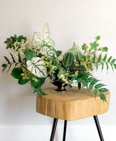 Love Love love all this texture. Lush all greenery centerpiece