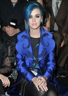Clearly Katy is taking a page out of Rooney's book, remaining in true Smurfette character.