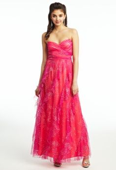 Bring a glow of elegance and a touch of shimmer to your next social event while you attire in this outstandingly beautiful ballgown. A ruched strapless bodice gives you a breathtaking figure and a full corkscrew ruffle skirt flows effortlessly as you party the night away! Wear this as a prom dress, guest of wedding dress, or as a fun cocktail dress. Finish the look with high heel lucite sandals, a cluster teardrop earring, and a crystal beaded clutch.